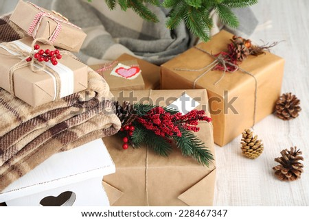 Christmas presents  near Christmas tree on wooden background - stock photo