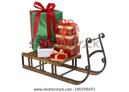 Christmas presents on wooden sleigh on white background  - stock photo