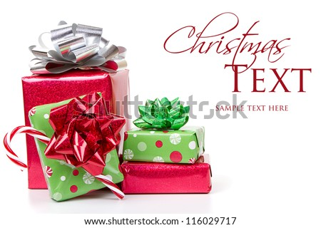 Christmas presents stacked up on white background - stock photo