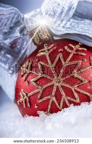 Christmas red ball or candle with golden ornaments,silver ribbon and snow. Christmas time - stock photo