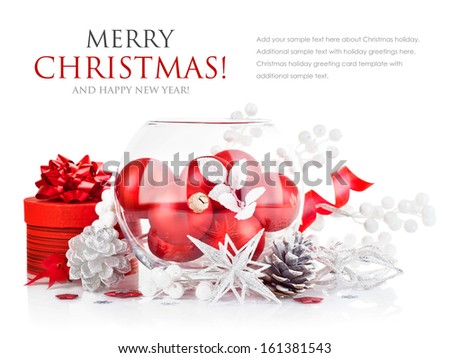 christmas red ball with festive tinsel isolated on white background - stock photo