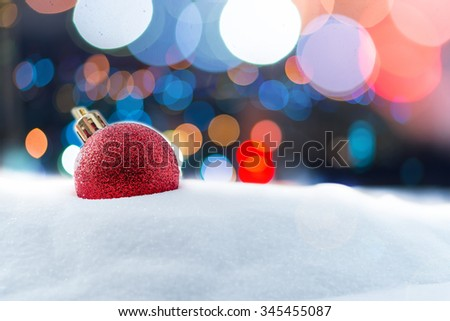 Christmas red balls decorations on snow and Abstract bokeh backgrounds - stock photo