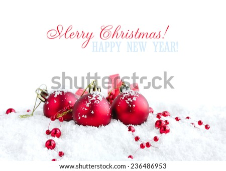 Christmas red balls on snow on white background - stock photo