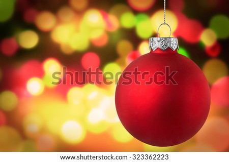 Christmas red bauble over bokeh background - stock photo