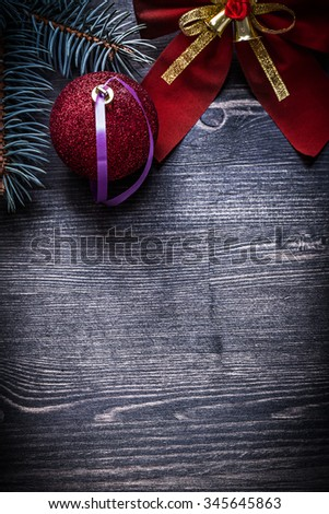 Christmas red bow ball evergreen pine branch copyspace holidays concept. - stock photo