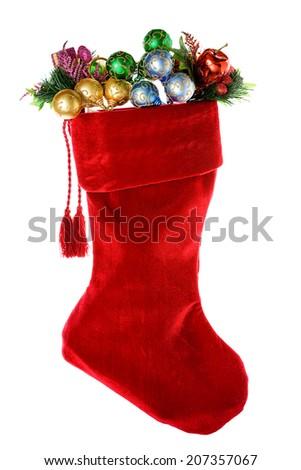 Christmas: Red Velvet Stocking Full Of Ornaments - stock photo
