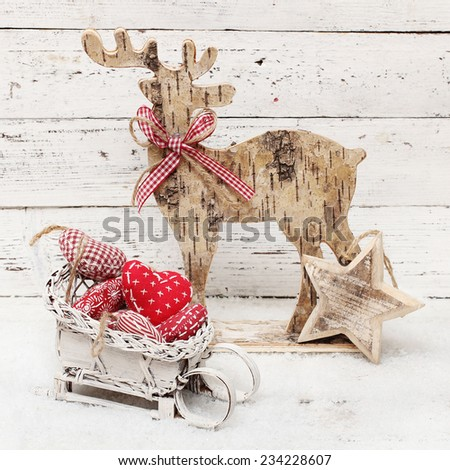 Christmas Reindeer on wooden background in scandinavian style - stock photo