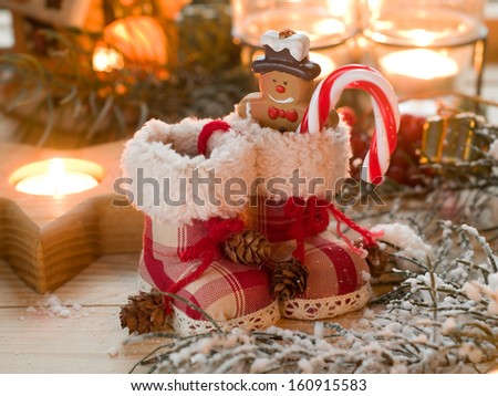 Christmas retro boots in candle light, selective focus - stock photo