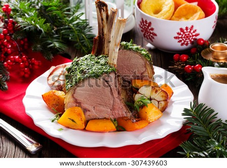 Christmas roast beef with Yorkshire pudding and roasted vegetables. Festive dinner. - stock photo