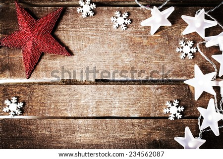 Christmas rustic background with lights, snowflakes, stars and free text space. Festive vintage planked wood with copyspace  - stock photo