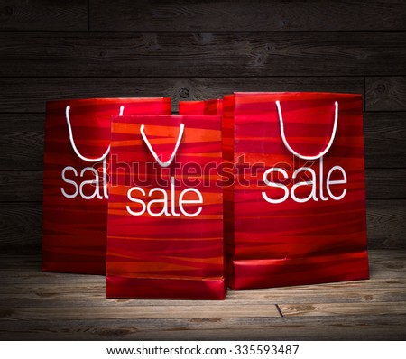Christmas - Sale bag , rebate ,on wood background  - stock photo