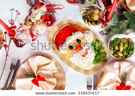 Christmas Santa Claus face salad serving New Year's table - stock photo