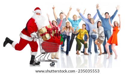 Christmas Santa Claus running with shopping cart - stock photo