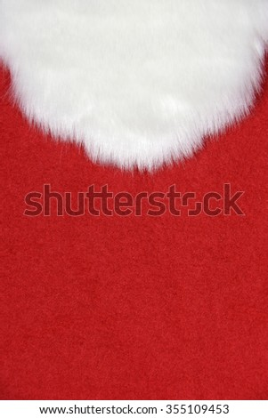 Christmas Santa Claus white furry beard on bold red fabric - stock photo