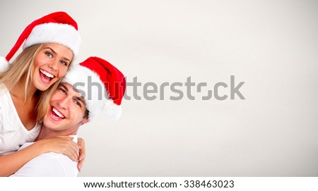Christmas Santa couple over blue banner background - stock photo