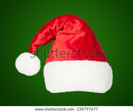 Christmas Santa red hat isolated on green background - stock photo