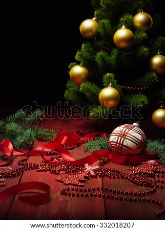 Christmas scene with Christmas tree and ball on black background - stock photo