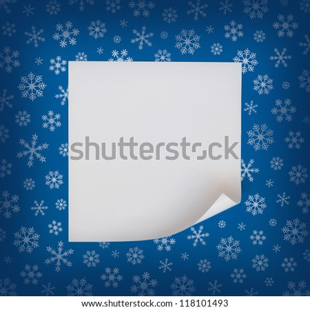 Christmas sheet of curved paper on blue snowflakes background - stock photo