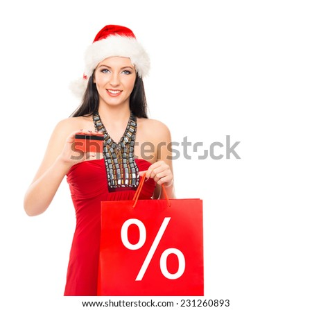 Christmas shopper woman with a credit card isolated on white  - stock photo
