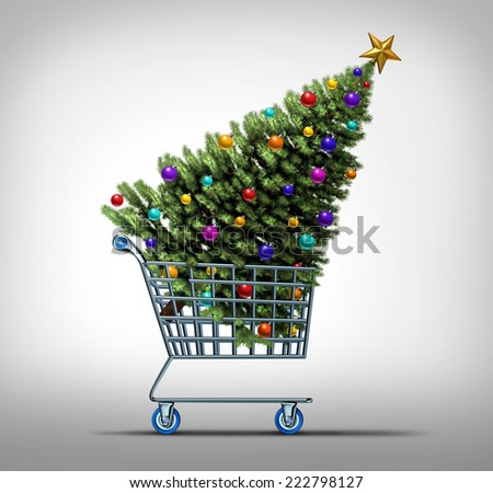 Christmas shopping concept as a store shop cart hauling a decorated festive holiday pine tree as a symbol for black friday sale or purchasing gifts and sales online. - stock photo