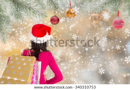 Christmas Shopping. Happy young girl with shopping bags. - stock photo