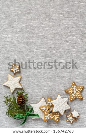 Christmas Silver background with firtree and ginger cookies. - stock photo