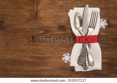 Christmas silverware on dark wooden table - stock photo
