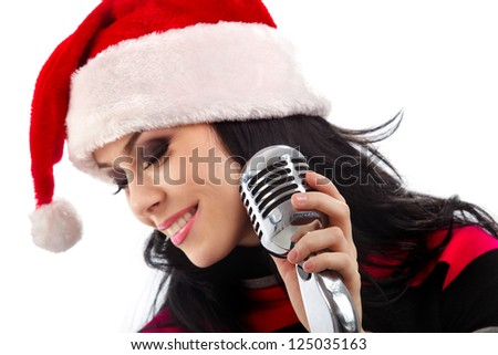 Christmas Singer standing in front of a microphone. Isolated on a white background (focus on microphone) - stock photo