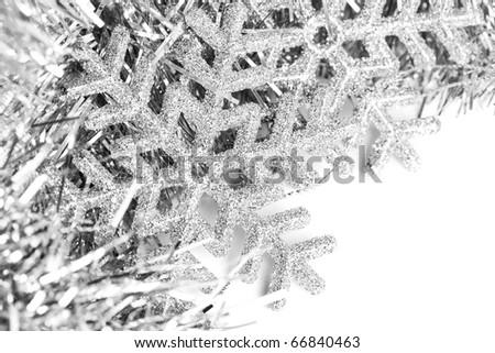 Christmas snowflake with festive garland - stock photo