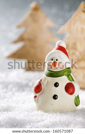 Christmas snowman in winter forest - stock photo