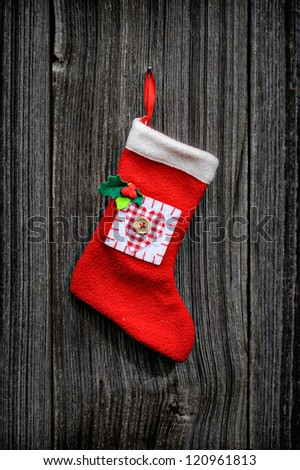 Christmas sock on the wooden background - stock photo