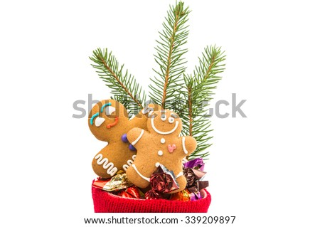 Christmas sock with Gingerbread man on a white background - stock photo
