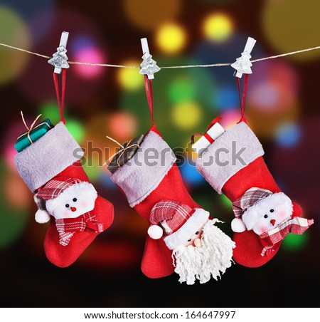 Christmas socks hanging on a background garlands blinking - stock photo