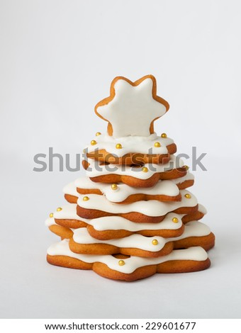 christmas spice cake in the form of fir on the white background - stock photo