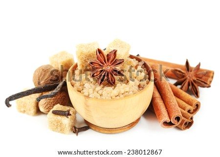 Christmas spices and baking ingredients isolated on white - stock photo