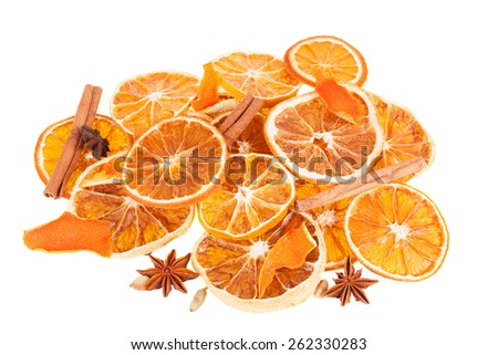 Christmas spices and dried orange slices isolated on white background - stock photo
