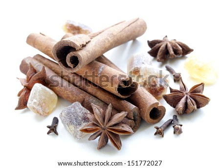 Christmas spices - cinnamon, cloves, star anise on white background - stock photo