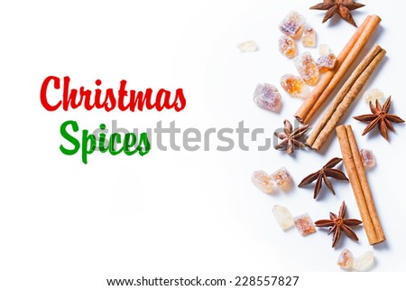 Christmas spices - cinnamon, star anise on white background - stock photo