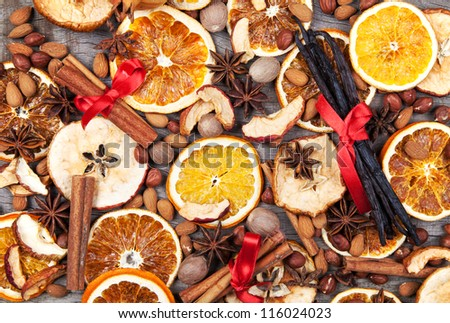 Christmas spices with dry orange and apple slices - stock photo