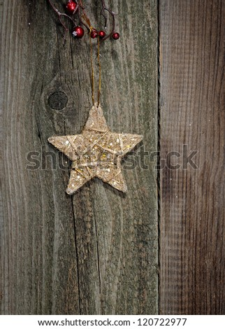 Christmas star against a wooden background. - stock photo