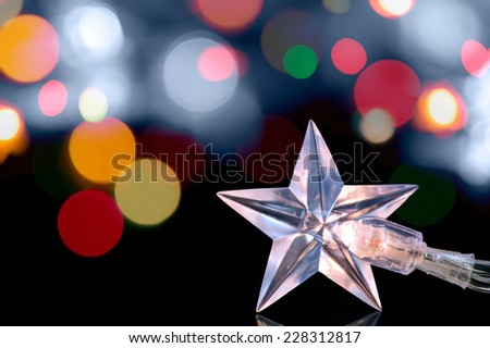 Christmas star lights against holiday defocused background - stock photo