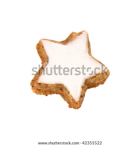 Christmas star shaped cookie with white icing isolated on white - stock photo