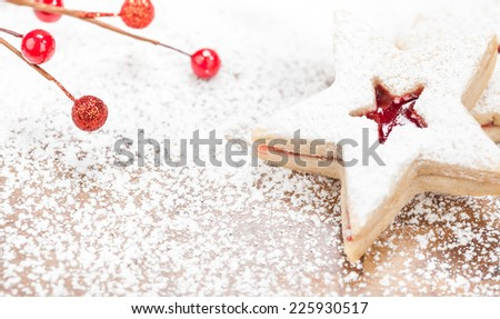 Christmas star shaped linzer cookie decorated with powdered sugar and red jam  - stock photo