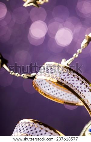 Christmas stars on sparkles background (shallow Dof) - stock photo