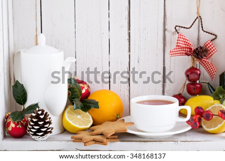 Christmas still life in a white shabby chic cupboard with ornaments - stock photo