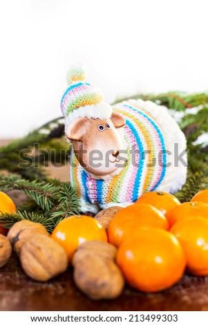 Christmas still life. Lamb, tangerines, spruce twig - stock photo