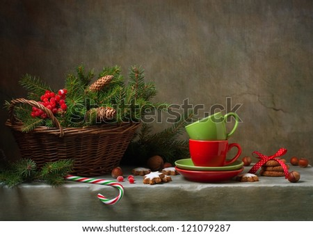 Christmas still life with cups and candy cane - stock photo
