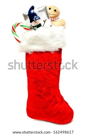 Christmas stocking filled with gifts and candy - stock photo