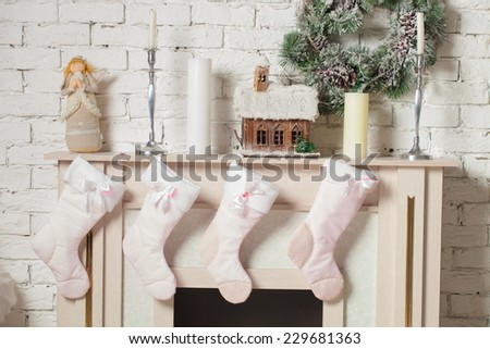 Christmas stocking hung by the chimney - stock photo