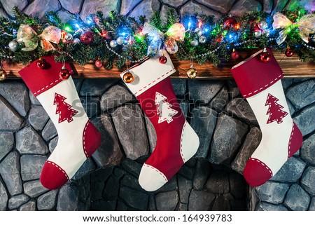 Christmas stocking on fireplace background - stock photo